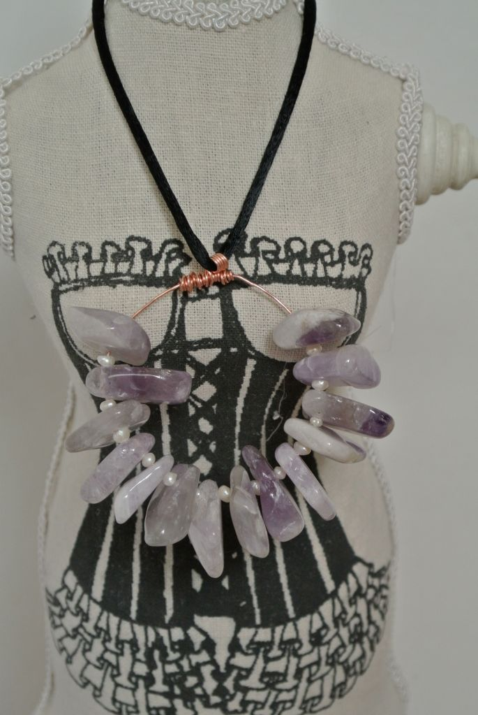 Dress form with amethyst necklace